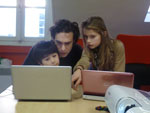 Emma helping Jim and Léo with Scratch